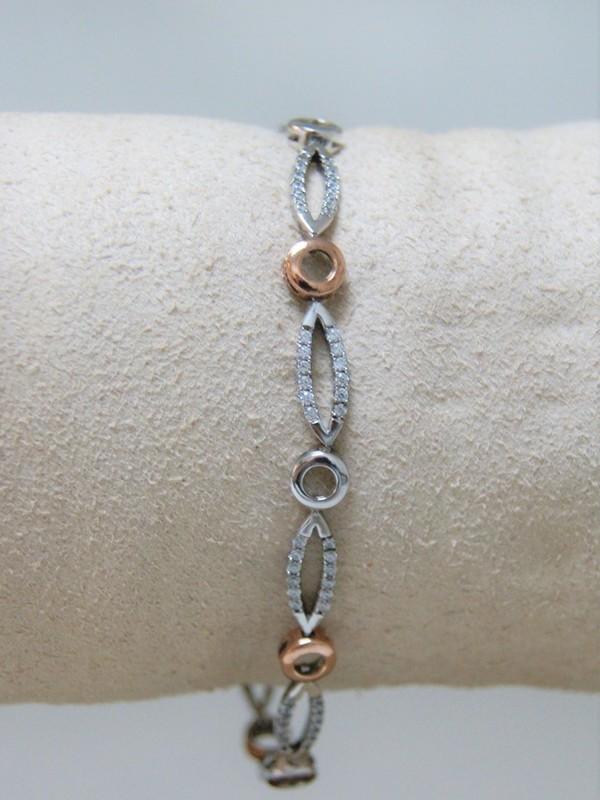 Zilveren-rosé armband met zirconia