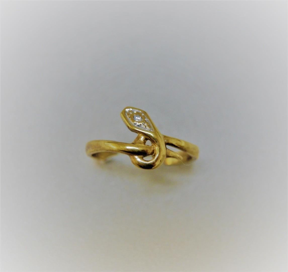 Gouden slangen ring met zirconia
