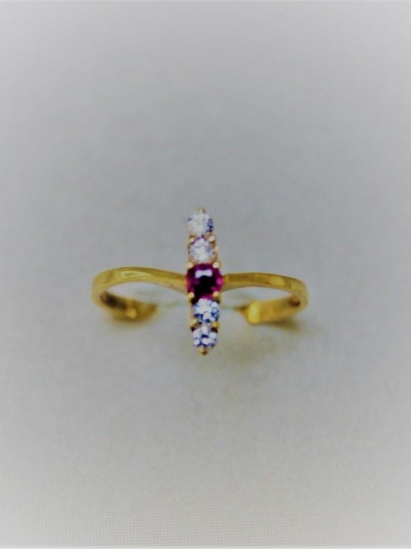 Gouden ring met robijn en zirconium