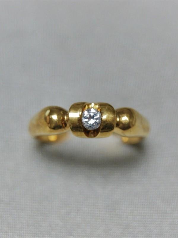 Gouden ring met span zetting van briljant