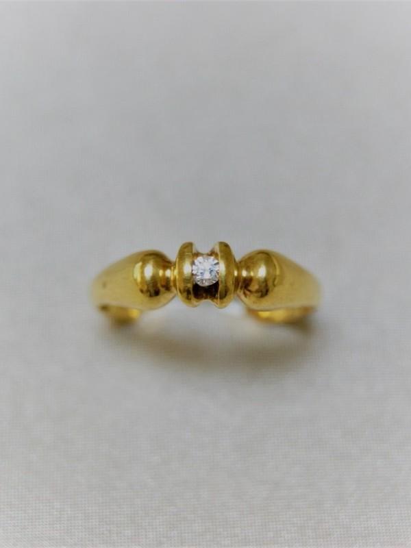 Gouden ring met briljant in span zetting
