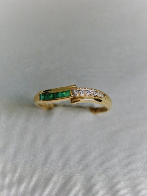 Gouden toi et moi ring met railzetting van briljante en peridot