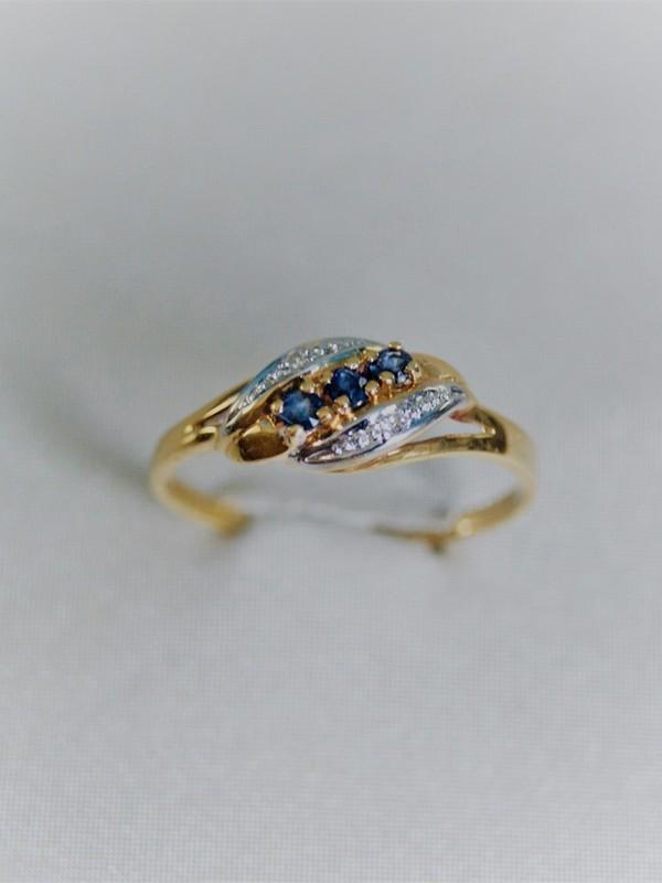 Gouden ring met zirconia en saffieren
