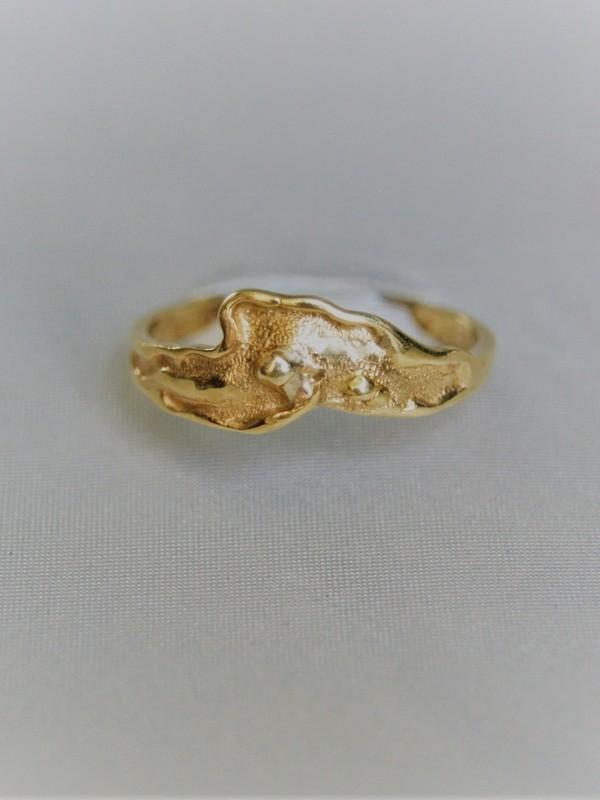 Gouden relief ring