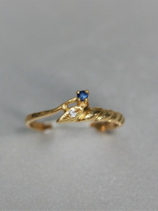 Gouden toi et moi ring met saffier en zirconium