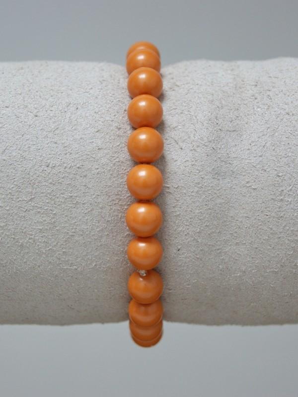 Armband met oranje parels