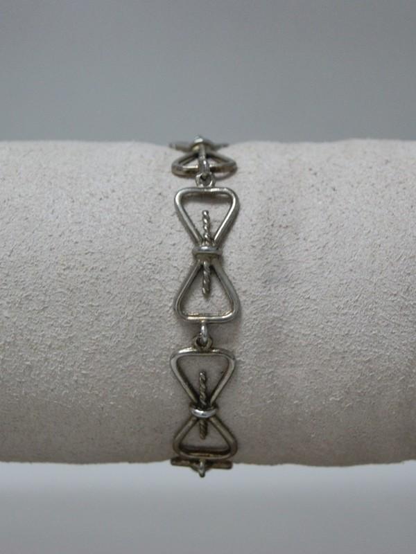 Zilveren ketting met strikjes motief