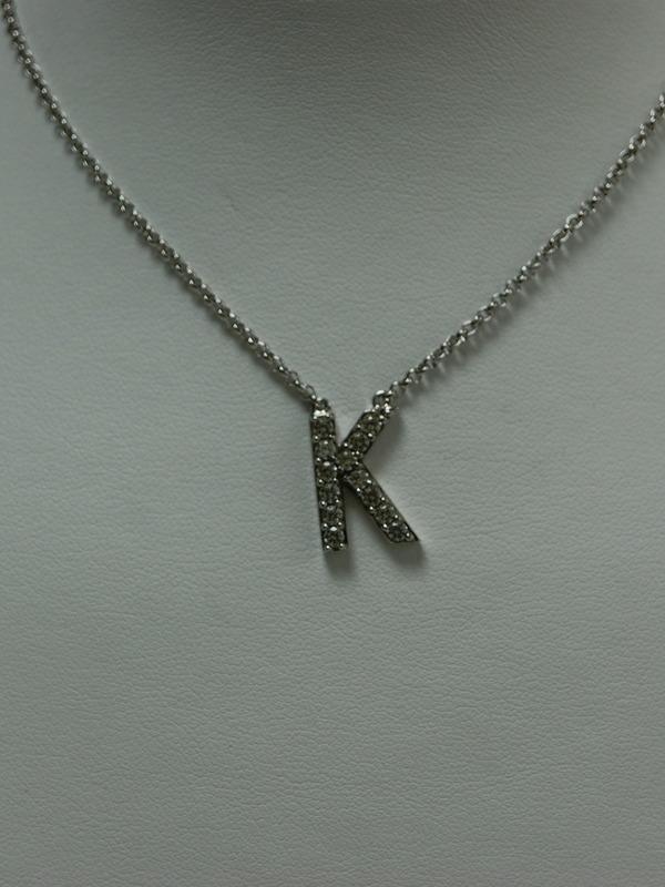 Zilveren collier met letter K-hanger en ingezette zirconia